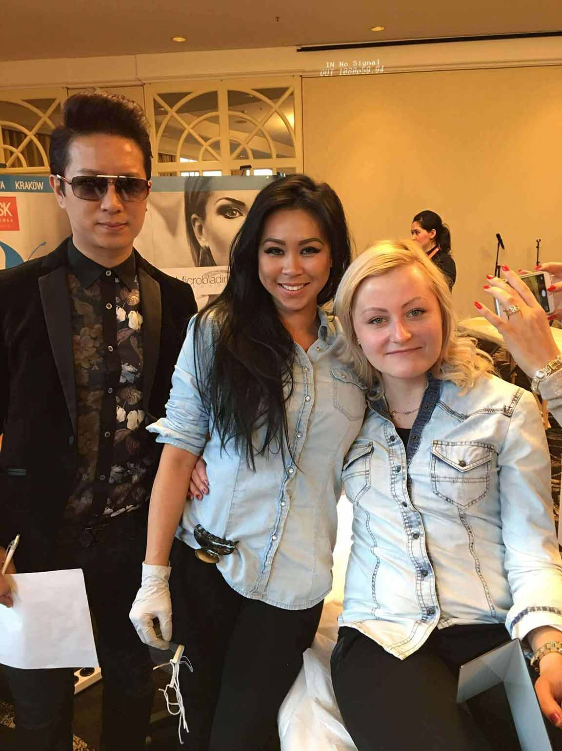 World of Microblading Judge David Zhang with champion Lindsey Ta and model